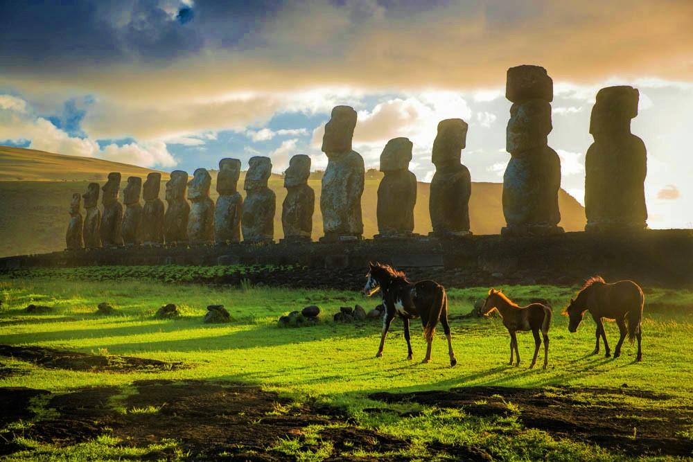 Horses roam in front of Ahu Tongariki on Easter Island's east coast.