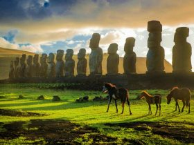 Horses roam in front of Ahu Tongariki on Easter Island's east coast.